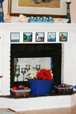 Fireplace tile installation using Besheer Art Tile Nautical Designs
