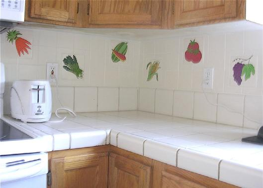 "FRUIT TILES and VEGETABLE TILES in 6"" x 6"" SIZE, ARE SKILLFULLY SET IN A FIELD OF 4"" x 4"" TILES. A CREATIVE KITCHEN BACKSPLASH INSTALLATION USING BESHEER ART TILE"